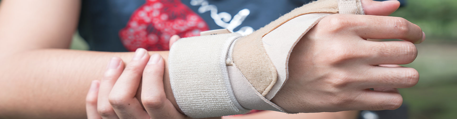 injured woman with wristband compression